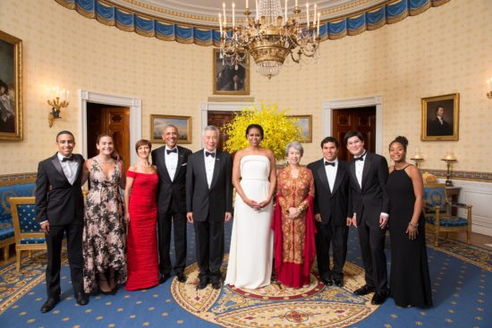 President Barack Obama, First Lady Michelle Obama, Prime Minister Lee Hsien Loong of Singapore and Mrs. Lee Hsien Loong join State Dinner performers, Project STEP from Boston, Mass., for a group photo in the Blue Room of the White House. (Photo credit: Official White House Photo by Chuck Kennedy)